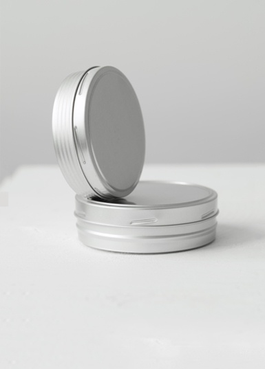 Round-tin-with Twist Closure